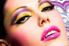 Beautiful face of a woman with fashion makeup Stock Photo