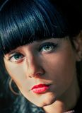 Closeup of the face of black haired women with big eyes Royalty Free Stock Images