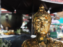 Closeup face of buddha statue with motion blur of background Stock Photo