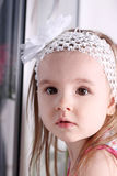 Closeup of face of cute little blond girl with white headband Royalty Free Stock Photography