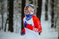Closeup face in frost elderly woman athletes running in cold weather in winter woods Royalty Free Stock Images