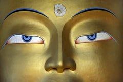 Closeup face of the golden Buddha statue, the Himalayas, Tibet. Stock Photo