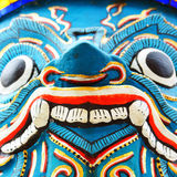 Closeup face of guardian giant at stupa base in grand palace Stock Photo
