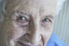 Closeup face of a lovely senior person Stock Images