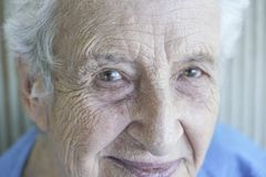 Closeup face of a lovely senior person Royalty Free Stock Images