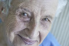 Closeup face of a lovely senior person royalty free stock image