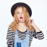 Closeup face portrait of teenage blonde girl in studio royalty free stock photography