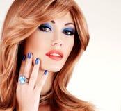 Closeup face of a sensual beautiful woman with blu Royalty Free Stock Photo