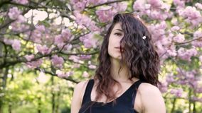 Closeup face of young dancer woman in the park. stock footage