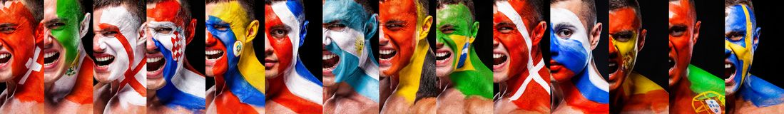 Closeup face of soccer or football fans with bodyart on face with agression emotion. Country flags. Football of fan are cheering for their team victory royalty free stock photography