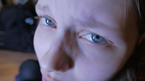 Closeup of a face of unhappy teen girl. 4K UHD. stock video footage