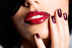 Closeup face of a woman with beautiful sexy red lips and dark na Royalty Free Stock Photography