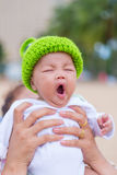 Closeup of face of yawning lying baby Stock Image
