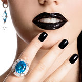 Closeup face of young beautiful woman with black manicure Stock Photography