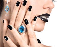 Closeup face of young beautiful woman with black manicure Royalty Free Stock Photo