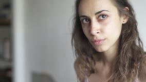 Closeup face of young beautiful woman mixed race at home. Woman looking sad and serious at first and then cute smiling. Closeup face of young beautiful woman stock video footage