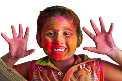 Closeup face young boy playing Holi smiling Royalty Free Stock Image