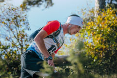 Closeup face of young man runner around autumn landscape Stock Images
