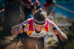 Closeup face young woman athlete with nordic walking poles Stock Images