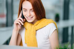 Closeup facial portrait of happy redhead woman on mobile phone call Stock Photo