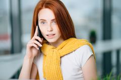 Closeup facial portrait of happy redhead woman on mobile phone call stock photos