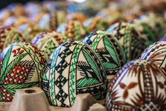 Closeup of factory-made decorated wooden, Easter egg. Concept Eas Stock Photo