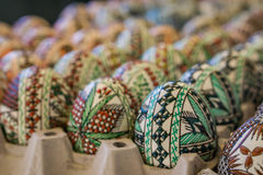 Closeup of factory-made decorated wooden, Easter egg. Concept Eas Royalty Free Stock Photography