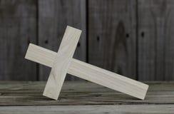 Closeup fallen wooden cross with rustic wooden background