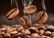 Free Closeup Falling Coffee Bean With Smoke On Brown Background Royalty Free Stock Photos - 87736318
