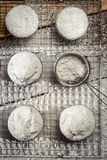 Closeup of falling icing sugar on fresh vanilla muffins Royalty Free Stock Images