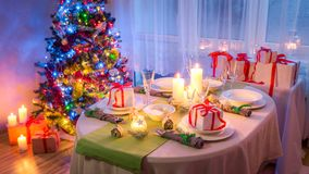 Family Christmas table setting with green and white decoration Stock Image