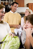 Closeup family in kitchen looking at each other Stock Photos