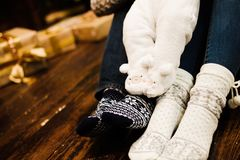 Closeup of family warming feet. Closeup photo of family newborn feet at wooden floor royalty free stock image