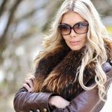 Closeup fashion beautiful woman portrait with long hair wearing Stock Images