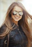 Closeup fashion beautiful woman portrait with long hair wearing Stock Image