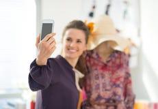 Closeup on fashion designer taking self photo Royalty Free Stock Photos