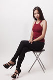 Closeup fashion portrait of asian young sexy woman posing in stu. Dio. sit on chair Royalty Free Stock Photography