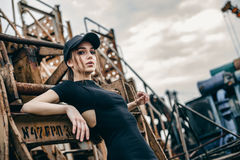 Closeup fashion portrait of hipster young tender woman in black cap royalty free stock photo