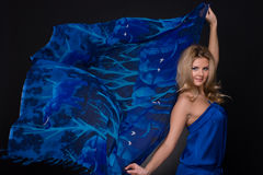 Closeup of fashion woman with blue flying scarf Royalty Free Stock Images