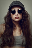 Closeup fashion woman portrait in glasses and cap Royalty Free Stock Photo