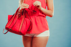 Closeup of fashion woman with red handbag. Royalty Free Stock Images