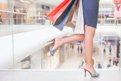 Closeup fashion woman's legs runs for shopping discounts Royalty Free Stock Photo