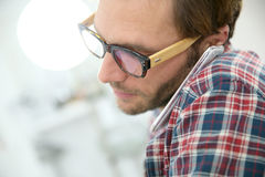 Closeup of fashionable man talking on smartphone Royalty Free Stock Photos