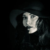 Closeup fashionable portrait of beautiful, pretty girl in black hat stock photo