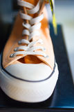 Closeup fashionable sneakers on shop shelf Stock Images
