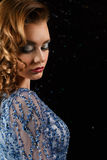 Closeup fashionable woman in blue dress with rhinestones Stock Image