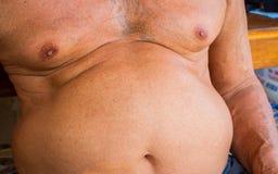 Closeup fat asian man has a big paunch.  Royalty Free Stock Photo