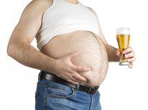 Closeup fat belly with beer isolated on white background Stock Photos