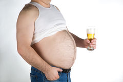 Closeup fat belly with beer  on white background Royalty Free Stock Images