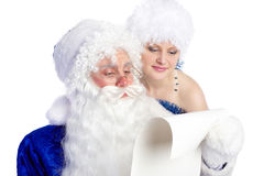 Closeup of Father Frost reading list of presents Royalty Free Stock Image